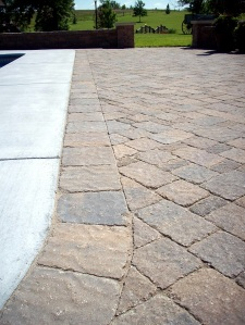 detail of bergerac pavers cuts next to pool near manhattan kansas